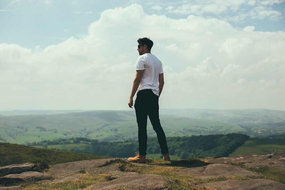 man looking over cliff